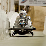 8 January 2016: Oskars Kibermanis, piloting his 2-man bobsled for Latvia, enters the Chicane straightaway on his second run, ending the day with a combined 2-run time of 1:51.48 and earning a 10th place finish at the BMW IBSF World Cup Championships at the Olympic Sports Track in Lake Placid, New York, USA. Mandatory Credit: Ed Wolfstein Photo *** RAW (NEF) Image File Available ***