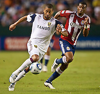 CARSON, CA – August 27, 2011: Real Salt Lake forward Alvaro Saborio (15) attempts to move the ball past Chivas USA defender David Junior Lopes (77) during the match between Chivas USA and Real Salt Lake at the Home Depot Center in Carson, California. Final score Chivas USA 0, Real Salt Lake 1.