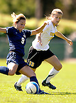 2 September 2007: University of Vermont Catamounts' Caitlin McGowan, a Freshman from Rye, NY, battles Nicole Trickett (9), a Senior from Eugene, OR, during game action against the George Washington University Colonials at Historic Centennial Field in Burlington, Vermont. The Colonials rallied to defeat the Catamounts 2-1 in overtime during the TD Banknorth Soccer Classic...Mandatory Photo Credit: Ed Wolfstein Photo