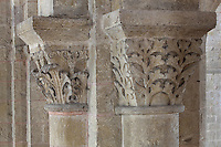 Carved capitals with foliage and acanthus leaf designs, between the nave and the ambulatory of the Abbatiale Sainte-Foy de Conques or Abbey-church of Saint-Foy, Conques, Aveyron, Midi-Pyrenees, France, a Romanesque abbey church begun 1050 under abbot Odolric to house the remains of St Foy, a 4th century female martyr. The church is on the pilgrimage route to Santiago da Compostela, and is listed as a historic monument and a UNESCO World Heritage Site. Picture by Manuel Cohen
