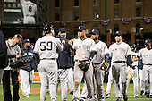 New York Yankees celebrate the season's first victory over the Baltimore Orioles at Oriole Park at Camden Yards in Baltimore, MD on Monday, April 9, 2012.  The final score was 6 - 2..Credit: Ron Sachs / CNP.(RESTRICTION: NO New York or New Jersey Newspapers or newspapers within a 75 mile radius of New York City)