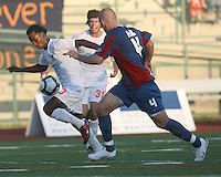 Shaun Pejic #4 of Crystal Palace Baltimore closes in on Gregory Richardson #20 of the Carolina Railhawks during an NASL match at Paul Angelo Russo Stadium in Towson, Maryland on September 18 2010.