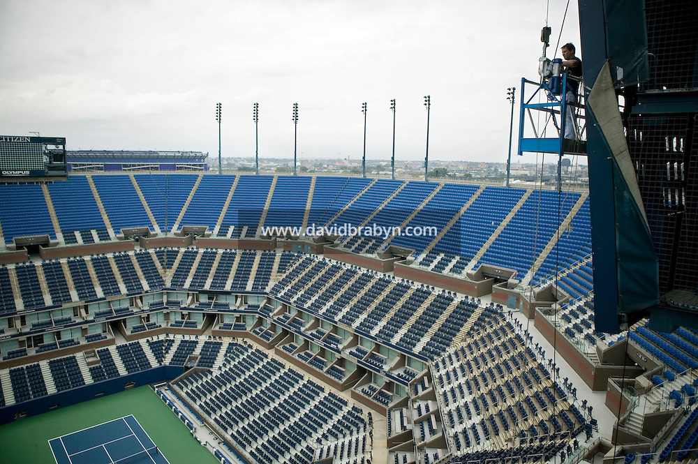 Flushing, NY - 19 August 2005 - A worker installs the giant electronic score board overlooking the Arthur Ash court at the National Tennis Center in Flushing, Queens, NY, USA, during preparations for the 2005 US Open, 19 August 2005.