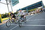 Youth ride their bikes as families picnic during National Night Out at Montclaire Elementary School in Los Altos, CA August 6.