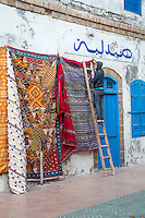 Essaouira, Morocco.  Hanging Rugs for Sale, Early Morning, Place Chefchaouini.