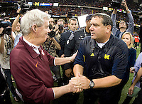 Michigan head coach Brady Hoke shakes hands with Virginia Tech head coach Frank Beamer after Michigan wins Sugar Bowl game at Mercedes-Benz SuperDome in New Orleans, Louisiana on January 3rd, 2012.  Michigan defeated Virginia Tech, 23-20 in first overtime.