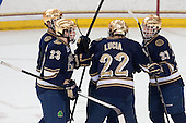 Eric Johnson (ND - 23), Mario Lucia (ND - 22) and Austin Wuthrich (ND - 27) celebrate a goal. - The visiting University of Notre Dame Fighting Irish defeated the Boston College Eagles 7-2 on Friday, March 14, 2014, in the first game of their Hockey East quarterfinals matchup at Kelley Rink in Conte Forum in Chestnut Hill, Massachusetts.