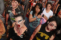 D.F. Mexico, November 23. 2013. Thousands of people dressed as zombies take part in a march from the plaza of the three cultures on the Paseo de la Reforma Avenue to the Angel of Independence.  VIEWpress/Miguel Angel Pantaleon