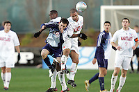 Maryland's A.J. Godbolt (right) heads the ball over SMU's Bruno Guarda (8). The University of Maryland defeated Southern Methodist University 4-1 in the NCAA Semifinal at SAS Stadium in Cary, North Carolina, Friday, December 9, 2005.