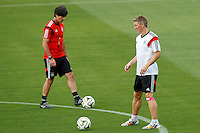 Germany manager Joachim Low and Bastian Schweinsteiger during training