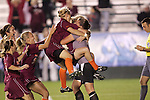 07 November 2008: Virginia Tech teammates mob goalkeeper Kristin Carden (in grey) following victory in the penalty kick shootout. The University of Virginia and Virginia Tech played to a 1-1 tie after 2 overtimes at WakeMed Stadium at WakeMed Soccer Park in Cary, NC in a women's ACC tournament semifinal game.  Virginia Tech advanced to the final on penalty kicks, 2-1.