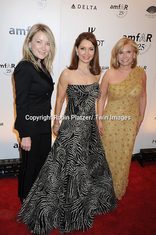 Janna Bullock, Jean Shafiroff and Sharon Bush attending the amfAR New York Gala on February 9, 2011 at Cipriani Wall Street in New York City. Dame Elizabeth Taylor, President Bill Clinton and Diane von Furstenberg were honored.