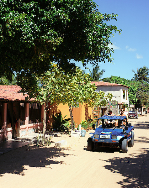JERICOACOARA, BRAZIL: A dune buggy drives down the sandy back streets of  Jericoacoara, Brazil .