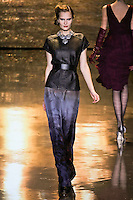 Alla Kostromichova walks runway in an outfit from the Badgley Mischka Fall 2011 fashion show, during Mercedes-Benz Fashion Week Fall 2011.
