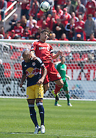 27 April 2013: New York Red Bulls forward Thierry Henry #14 and Toronto FC defender Darren O'Dea #48 in action during the first half in an MLS game between the New York Red Bulls and Toronto FC at BMO Field in Toronto, Ontario Canada....