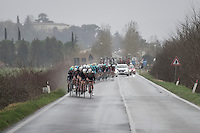 UAE Team Emirates forcing the pace in the heavy rain with this large group in an attemp to close the gap to the elite group ahead (where none of their riders is represented)<br /> <br /> 11th Strade Bianche 2017