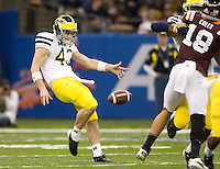 Will Hagerup of Michigan punts the ball during Sugar Bowl game against Virginia Tech at Mercedes-Benz SuperDome in New Orleans, Louisiana on January 3rd, 2012.  Michigan defeated Virginia Tech, 23-20 in first overtime.