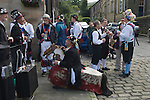 Uppermill, Saddleworth, Yorkshire. UK. Bank holiday weekend Morris teams. The Hobby Horse is from the Silkeborg Morris team in Denmark.
