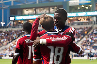 Chris Rolfe (18) of the Chicago Fire celebrates scoring with Jalil Anibaba (6). The Chicago Fire defeated the Philadelphia Union 3-1 during a Major League Soccer (MLS) match at PPL Park in Chester, PA, on August 12, 2012.
