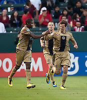 Philadelphia Union forward Danny Mwanga (10) gets congratulations on this goal from midfielder Stefani Miglioranzi (6) during the first half of the game between Chivas USA and the Philadelphia Union at the Home Depot Center in Carson, CA, on July 3, 2010. Chivas USA 1, Philadelphia Union 1.