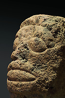 Tiki head in red volcanic rock, 32cm tall, with prominent eyes and open mouth, from the Havao de Taiohae Valley, Nuku Hiva, Marquesas Islands, in the Musee de Tahiti et des Iles, or Te Fare Manaha, at Punaauia, on the island of Tahiti, in the Windward Islands, Society Islands, French Polynesia. Tikis are protective statues representing Ti'i, a half-human half-god ancestor who is believed to be the first man. The Museum of Tahiti and the Islands was opened in 1974 and displays collections of nature and anthropology, habitations and artefacts, social and religious life and the history of French Polynesia. Picture by Manuel Cohen