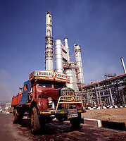 India. Characteristically flamboyant truck at modern chemical plant.