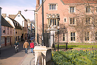 People walk and cycle down Magdalene street past Magdalene College in Cambridge, United Kingdom, 11 March 2007.