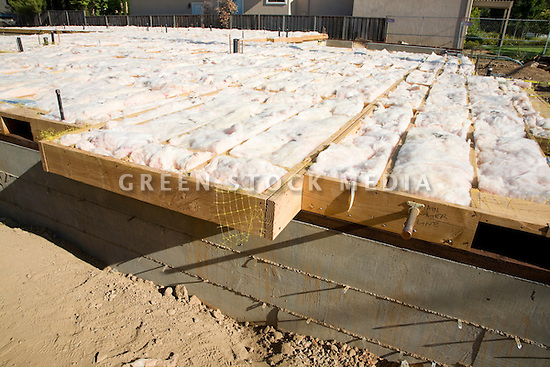Fiberglass batt insulation of residential home green for Insulation batt sizes
