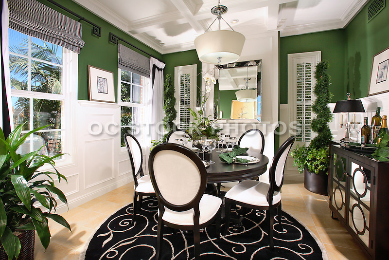 Interior decorated model home dining room with wainscoting for Model home dining room