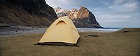 Wild tent camping at scenic Kvalvika beach, Moskenesøy, Lofoten Islands, Norway