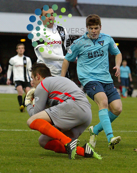 Pars Keeper Ryan Scully save this from a in rushing Michael Moffat. 4 th round of the William Hill Scottish Cup the game between Ayr United V Dunfermline played at Somerset Park Picture by Alistair Mulhearn / Universal News and Sport (Scotland). All pictures must be credited to www.universalnewsandsport.com. (Office) 0844 884 51 22 30/11/2013