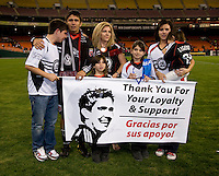 Jamie Moreno (99) of D.C. United and his family thank the assembled crowd for their support after his last game at RFK Stadium in Washington, DC.  Toronto defeated D.C. United, 3-2.