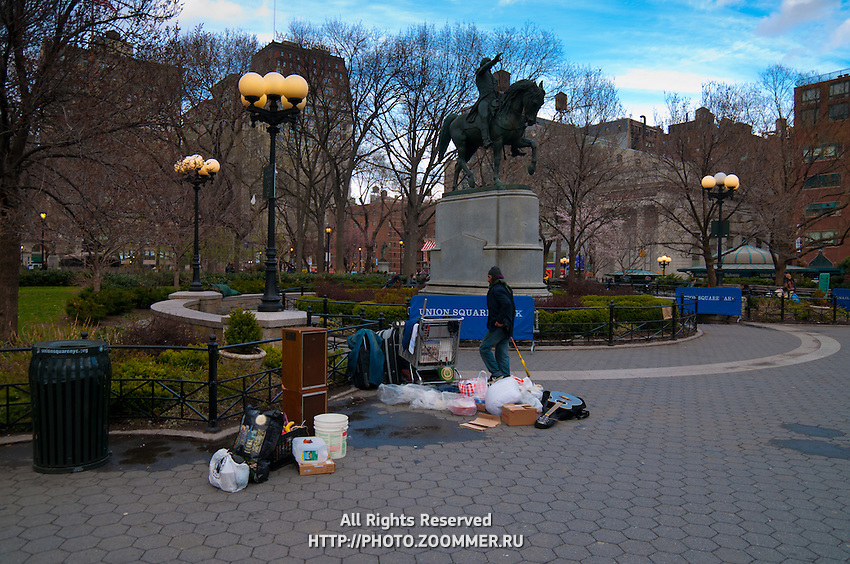 Hobo ner the Statue of George Washington in the park of Union Square in Manhattan, New York City