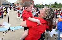 NWA Democrat-Gazette/J.T. WAMPLER Tina Andersen of Decater holds her son Remington, 3, Wednesday April 19, 2017 during a Make-A-Wish Foundation reveal at Mary Mae Jones Elementary School in Bentonville. Remington has brain cancer and students at the school raised funds to to cover the cost to send him to Disney World.