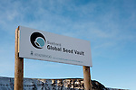 """Sign outside the Svalbard Global Seed Vault. Nestled into the rocky waste of plataberget Mountain about Svalbard's airport, the Global Seed Vault is at once startling and innocuous. Designed by architect Peter W. Søderman at Barlindhaug Consulting, this concrete, steel and glass structure is the first layer of security to a repository of millions of seeds from around the world, stored here in case of disaster, disease, or war...The Svalbard Global Seed Bank is situated 120 metres (390 ft) inside a sandstone.mountain at Longyearbyen on Spitsbergen Island, in the Svalbard archipelago about 1300km from the North Pole. Svalbard was considered ideal for the bank, due to low tectonic activity and its permafrost, which will aid preservation. Even if sea levels rise due to climate change - and the melting of ice caps, the seeds will be safe and dry , as they are stored at a location 130 metres (430 ft) above sea level. ..The Svalbard Global Seed Vault  provides a safety net against accidental loss of diversity from traditional storage within genebanks around the world, and has a capacity for 4.5 million seeds. Although the media has made much of the """"Doomsday Vault's"""" role in providing security in the face of war or or catastrophe, the operators - the Norwegian government  and the Global Crop Diversity Trust and the Nordic Genetic Resource Center - say that it will be most useful when genebanks lose samples due to mismanagement, accident, equipment failures, funding cuts and natural disasters."""