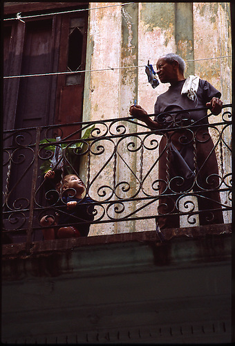 Young Boy and Grandad on Balcony, Havana, Cuba by Paul Cooklin