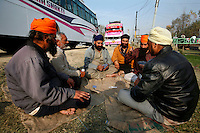 Indian tourists play cards as they are trapped for two days due to paramilitary police enforcing a curfew imposed to stop separists gather for a political demonstration in Srinagar, Kashmir, India. © Fredrik Naumann/Felix Features
