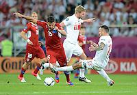 FUSSBALL  EUROPAMEISTERSCHAFT 2012   VORRUNDE Tschechien - Polen               16.06.2012 Milan Baros (li, Tschechische Republik) gegen Damien Perquis (Mitte) und Marcin Wasilewski (re, beide Polen)