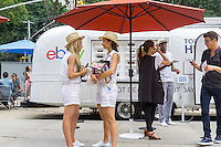 "Workers for eBay, iPads at the ready prepare to collect data from consumers at their ""Hot Deals for Hot Days"" promotion in Flatiron Plaza in New York on Tuesday, July 7, 2015. The branding promotion enables consumers to buy sunglasses at discounts corresponding to the high temperature of the day. Today's 83 F temperature gave buyers 83 percent off their purchase. (© Richard B. Levine)"