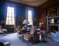 The panelled drawing room has a painted plasterwork ceiling and a marble fireplace