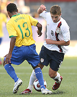 Robbie Rogers tangles with Amaral. USA stunned Brazil, winning 2-1 to finish first in their group. Final game in group D in Ottawa, Ontario, on JULY 6 2007.