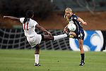 03 December 2010: Notre Dame's Julie Scheidler (right) and Ohio State's Tiffany Cameron (11). The Notre Dame Fighting Irish defeated the Ohio State University Buckeyes 1-0 at WakeMed Stadium in Cary, North Carolina in an NCAA Women's College Cup semifinal game.