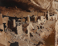 Cliff Palace, 1896, A white marble city, photograph by Thomas M McKee, 1854-1939, in the Chapin Mesa Archeological Museum, in Mesa Verde National Park, Montezuma County, Colorado, USA. Cliff Palace, 13th century, is a huge multi-storey Native American Puebloan dwelling, housing 125 people, with 23 kivas and 150 rooms, rediscovered in 1888. It is the largest cliff house in the park, possibly used for social and ceremonial purposes and is thought to be part of a larger community encompassing 60 pueblos and 600 people. It is made from sandstone blocks, mortar and wooden beams and was originally painted with earthen plasters. Mesa Verde is the largest archaeological site in America, with Native Americans inhabiting the area from 7500 BC to 13th century AD. It is listed as a UNESCO World Heritage Site. Picture by Manuel Cohen