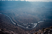 Trucks carry coal at the Kujama Fire Project, an open cast mine in Jharia, outside of Dhanbad in Jharkhand, India.  Photo: Sanjit Das/Panos