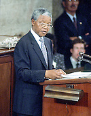 Washington, D.C. - June 26, 1990 -- Nelson Mandela, leader of the African National Congress (ANC) acknowledges the applause as he addresses a Joint Session of the United States Congress  in Washington, DC on Tuesday, June 26, 1990.  .Credit: Ron Sachs / CNP