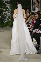 Model walks runway in an Andreea wedding dresses by Carolina Herrera, for the Carolina Herrera Bridal Spring 2012 runway show.