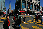 The Transamerica Pyramid skyscraper is visible as shoppers, locals, and tourist make their through the Chinatown district of San Francisco, California.  Jim Urquhart/Straylighteffect.com