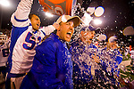 Folsom High School's #51 Yuvi Madra pours water on Folsom head coach Kris Richardson, far right, as Folsom High School beats Grant High in the Sac-Joaquin Section Division II championship at Hornet Stadium at Sacramento State University, Friday Dec. 3, 2010.Photo Brian Baer.