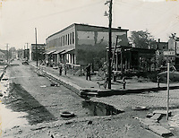 UNDATED..Assisted Housing..Tidewater Gardens (6-2 & 6-9)..Slum Conditions.1006 - 1018 East Charlotte Street.Looking West down Charlotte Street from Walke Street..McIntosh Studio.NEG#.648..