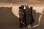 Children against a mud wall, Atlas Mountains, Morocco